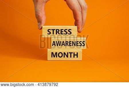 Stress Awareness Month Symbol. Wooden Blocks With Words 'stress Awareness Month'. Beautiful Orange B