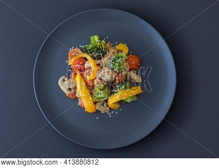 Delicious Salad With Ripe Vegetables On The Dark Table. Salad Made Of Broccoli, Cherry Tomatoes, Yel