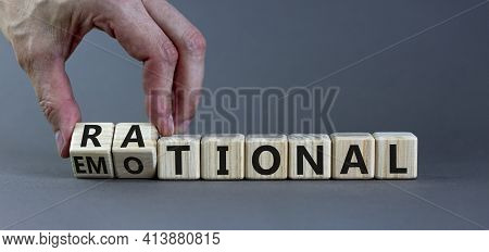 Rational Or Emotional Symbol. Psychologist Turns Wooden Cubes And Changed The Word 'rational' To 'em