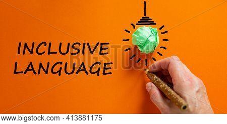 Inclusive Language Symbol. Businessman Writing Words 'inclusive Language', Isolated On Orange Backgr
