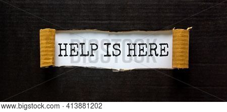 Support And Help Is Here Symbol. Words 'help Is Here' Appearing Behind Torn Black Paper. Beautiful B