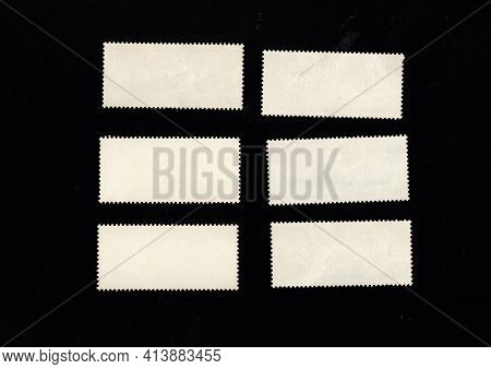 Reverse Side Of Stamp Isolated On Black Background. Postage Stamps On Other Side. Blank Postage Stam