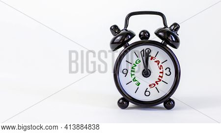 Time To Fasting Symbol. Beautiful Black Alarm Clock With Words 'eating Fasting'. Beautiful White Bac