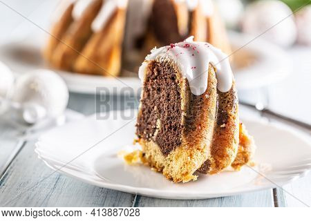 A Cut Piece Of Easter Marble Cake On A White Plate
