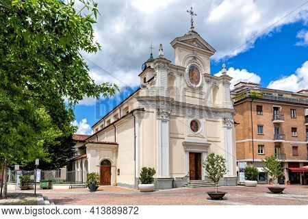 View of beautiful white San Giovanni Battista church on small town square in Alba, Piedmont, Northern Italy.