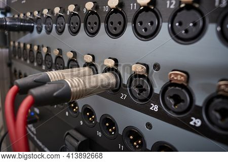 Jack-type Audio Connectors Inserted Into The Line Inputs Of A Mixing Desk With More Jack And Xlr Inp
