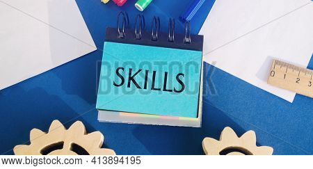 Notes With The Word Skills On A Blue Background. Knowledge And Skill. Self Improvement. Education Co