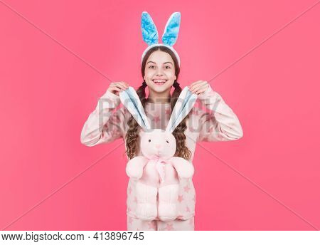 Lets Play. Happy Easter. Childhood Happiness. Child In Rabbit Ears And Pajamas. Time For Fun.