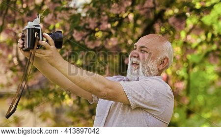 Memories In Snap. Everyone Photogenic. Senior Man Taking Selfie Photo Vintage Camera. Retro Equipmen