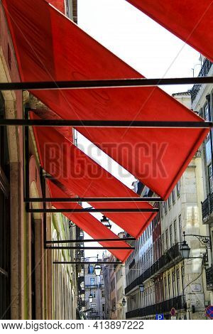 Red Awnings In The Streets Of Lisbon, Portugal