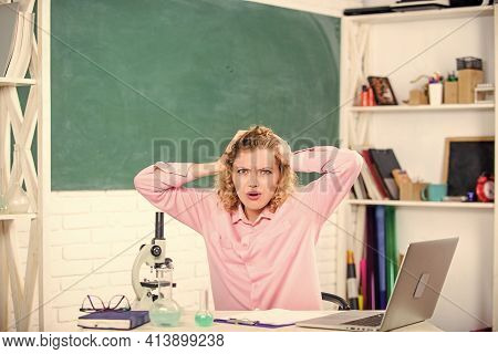Emotional People Concept. Woman Tutor Or Student At Desk With Laptop And School Equipment Stationery