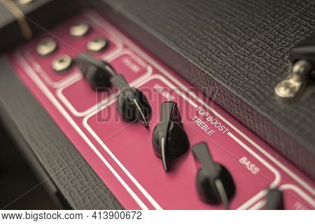 Close-up Of The Knobs Of A Classic Rock And Roll Music Amplifier, With Regulators For Volume, Bass A