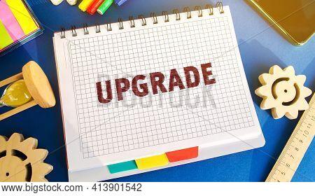Notebook With Inscription Upgrade. Improvement, Modernization And Renewal Concept. Upgrading Softwar