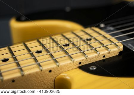 Details Of Steel Strings, Neck And Frets Of A Classic Electric Rock And Blues Guitar, Bright, On Gra