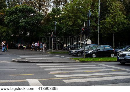 Car Traffic At Rush Hour In Downtown Area Of The City. Car Pollution, Traffic Jam In The Morning And