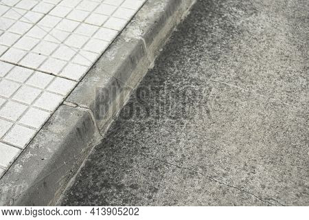 Grey Sidewalk Of Concrete And Curb Of A Street In A City Of Spain
