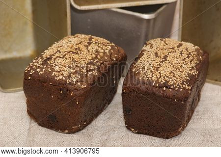 Rye Bread. Dessert Rye Bread With Raisins And Walnuts In Sourdough, Sprinkled With Sesame Seeds And