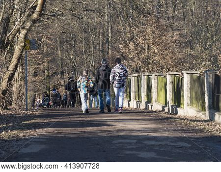Czech Republic, Prague, March 7, 2021: Crowdy Path In Kunraticky Les Forest Park With Bare Trees And