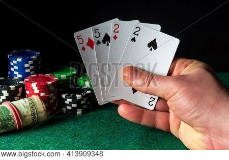Poker Cards With Two Pairs Combination. Close-up Of A Gambler Hand Is Holding Playing Cards In Casin