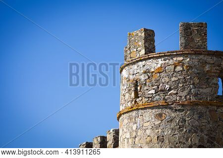 Tower With Battlements Of A Medieval Castle Located In The Southwest Of Spain, Next To The Border Wi