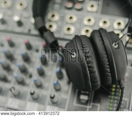 Black Disc Jockey Headphones On A Sound Mixer