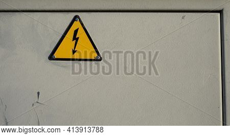 Electrical Panel With Label And Danger Signal Identifying The Risk Of Electric Shock Or Yellow And B
