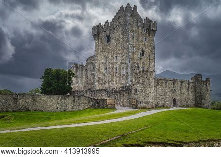 Old Keep From 15th Century, Ross Castle Located On The Bank Of Lough Leane With Dramatic Storm Cloud
