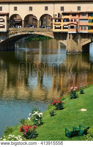 Vertical View Of Ponte Vecchio And The Arno River On A Beautiful Sunny Spring Day In Florence, Italy