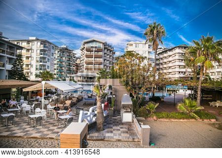 Alanya , Turkey- October 20, 2020:  Beautiful sunset view on cafe at Cleopatra Beach, popular among tourists for recreation. Alanya, Antalya district, Turkey, Asia