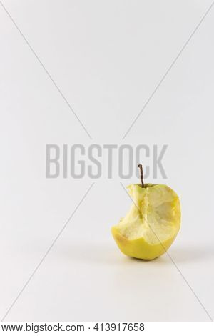 Golden Green Delicious Bitten Apple Isolated On White. Vertical Photo An Apple Stub.