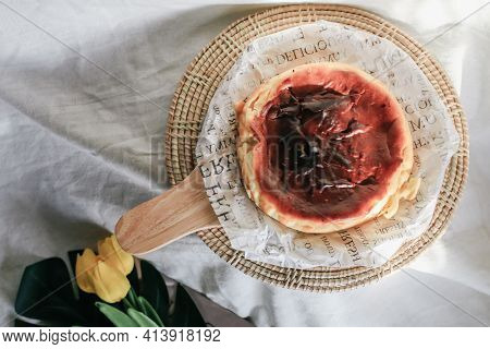 Basque Burnt Cheesecake With Sweetened Cream Cheese And Eggs And Cream Baked In A Crumb Crust. A Tra