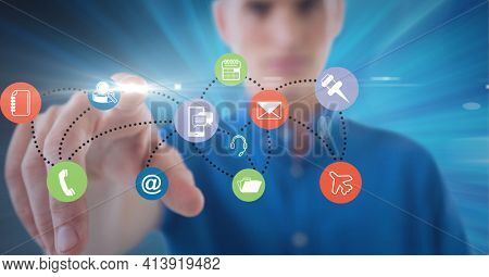 Composition of businesswoman touching network of digital icons. global technology and digital interface concept digitally generated image.