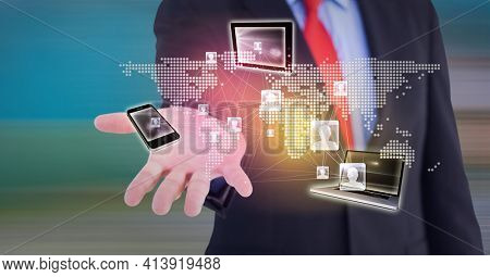 Composition of network of digital icons, world map and electronic devices over hand of businessman. global technology and digital interface concept digitally generated image.