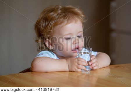 Healthy Nutrition For Kids. Baby Drink Water. Portrait Of A Sweet Beautiful Child Drinking A Glass O