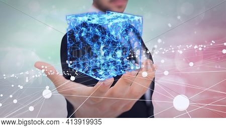 Composition of cube of network of digital icons over hand of businessman. global technology and digital interface concept digitally generated image.