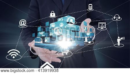Composition of network of digital icons with glow over hands of businessman. global technology and digital interface concept digitally generated image.