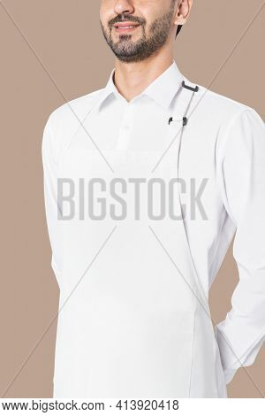Chef wearing simple white apron studio portrait