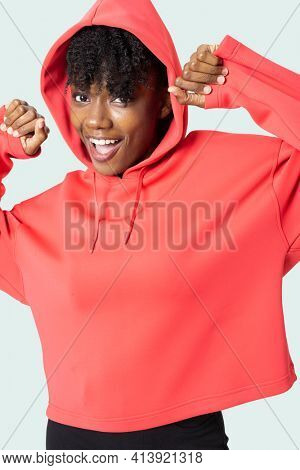 Sporty woman in red hoodie women's apparel photoshoot