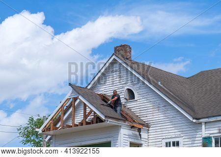 New Orleans, La - March 22: Worker Demolishes Section Of House In Preparation For Remodeling On Marc