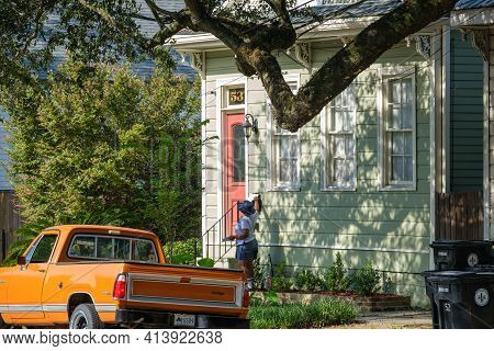 New Orleans, La - August 8: Mail Carrier Delivers Mail In Uptown Neighborhood On August 8, 2020 In N