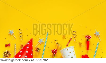 Happy Birthday Background: Party Hat, Serpentine, Stars, Cocktail Tubes, Candles, Blower On A Yellow