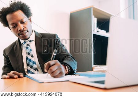 Businessman Working With Some Files At Office.