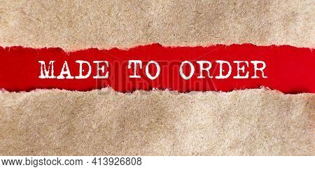 The Text Made To Order Appearing Behind Torn Paper. Business Concept