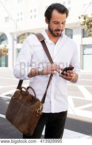 Casual business man in white shirt on his way to work outdoor photoshoot