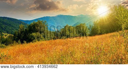Rural Field In Mountains At Sunset. Beautiful Summer Landscape Of Carpathian Countryside In Evening
