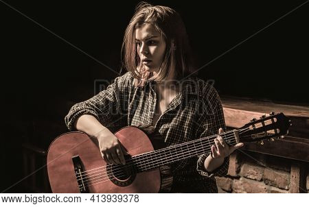 Woman Playing Guitar, Holding An Acoustic Guitar In His Hands. Music Concept. Girl Guitarist Plays.