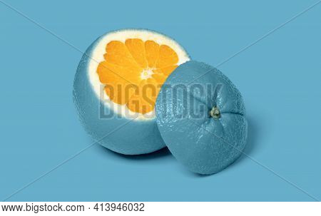 Weird Blue Sliced Orange Isolated On A Pink Background