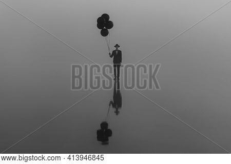Surreal Single Man In A Suit With A Hat With Balloons In His Hand On The Water