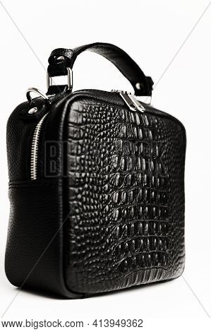 Women\'s Handbag In Black On A White Background. Details Of A Female Leather Bitch. Crocodile Skin T