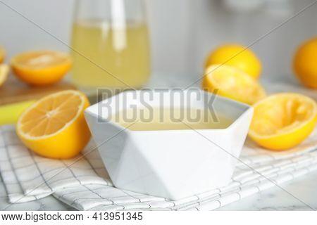 Freshly Squeezed Lemon Juice In Bowl On Table
